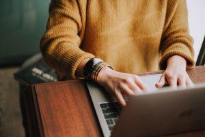 writer typing poetry mentoring